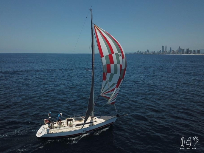 yacht under spinnaker with Surfers Paradise skyline
